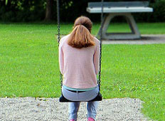 child sitting on a swing