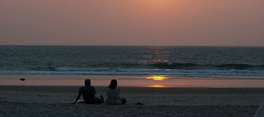 couple sitting alone on the beach