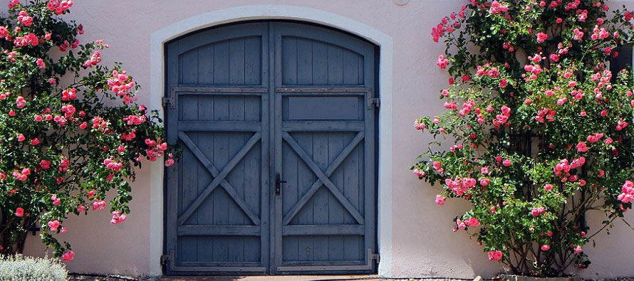door near and entrance with flowers